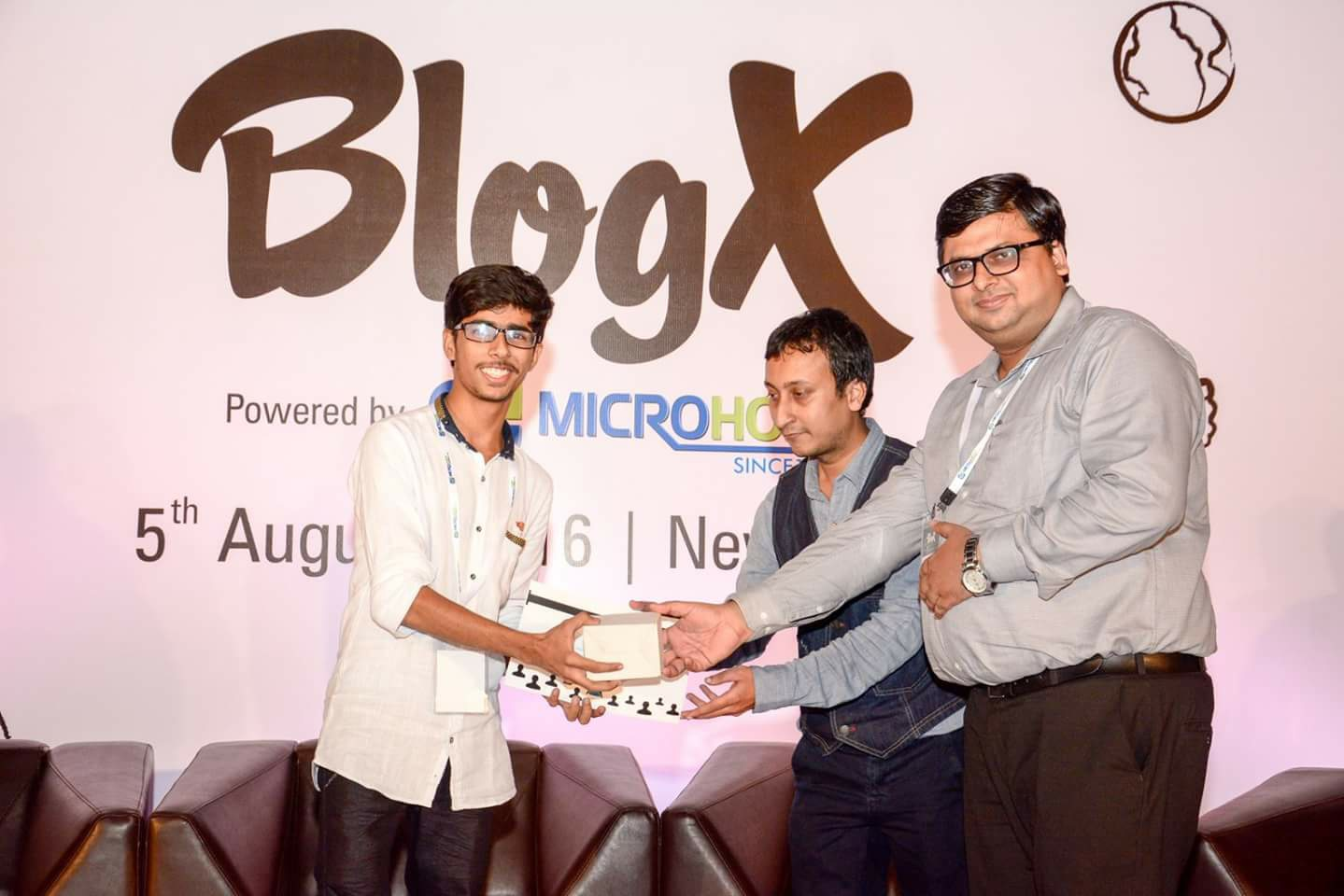 Getting Blogger of the year certificate from the founder of laughing colors Mr.Vinay